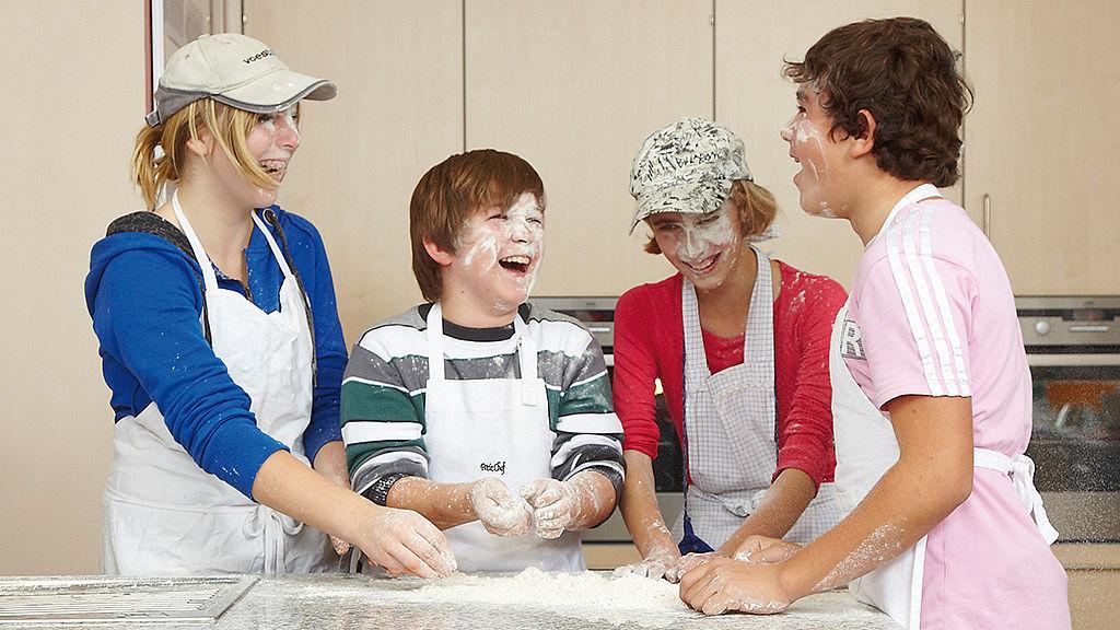 Image: Pupils making a dough mixture